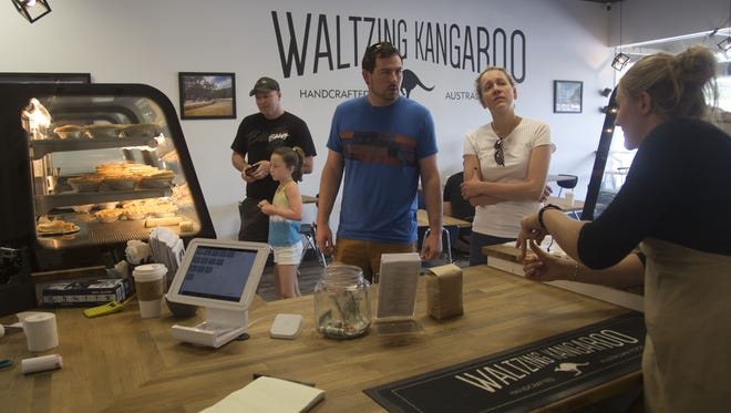 Customers look over the options at Waltzing Kangaroo in the Campus West neighborhood of Fort Collins. The Waltzing Kangaroo is the top-rated Fort Collins bakery, according to Yelp.