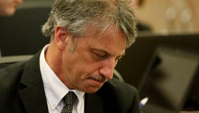 Dr. Daniel Baldi reflects Monday after hearing the judge drop two of the 9 counts against him.