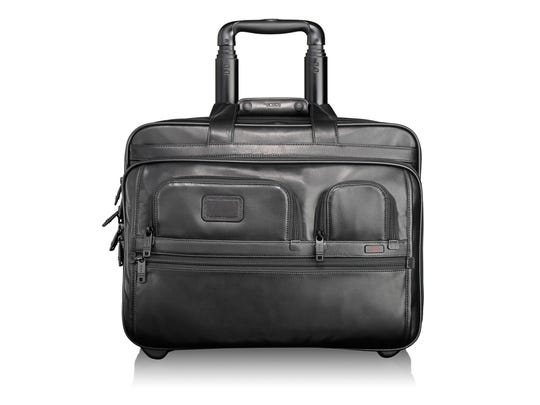 """Travel Channel's """"Hotel Impossible"""" host Anthony Melchiorri says his go-to bag is a leather Tumi rolling briefcase."""