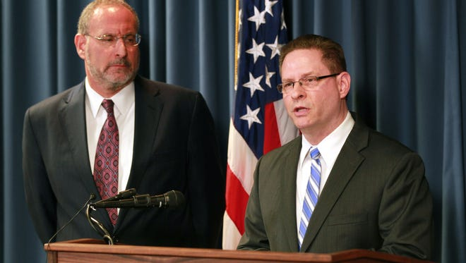 FBI special agent Richard Thornton, right, with United States Attorney Andrew Luger explain the criminal complaint charging six Minnesota men with terrorism at a news conference in Minneapolis on Monday.