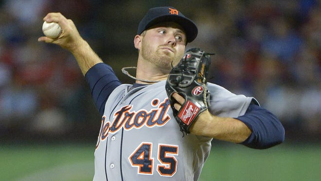 Detroit Tigers pitcher Buck Farmer throws during the third inning against the Texas Rangers at Globe Life Park in Arlington, Texas, on Tuesday, Sept. 29, 2015. The Rangers won, 7-6.