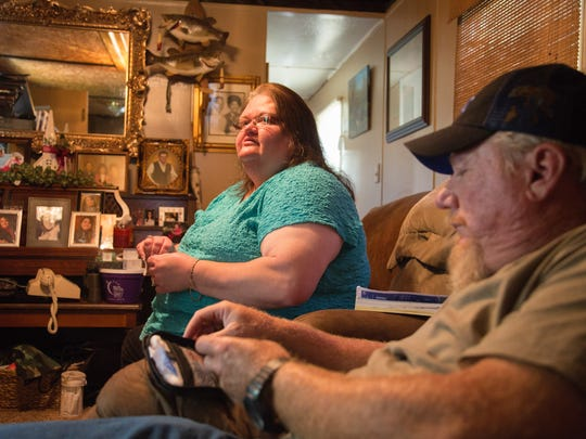 Alisha and Tony Blankenbeckler sit in a trailer they rent after having lost their house and property to foreclosure while fighting a long list of health care problems. The high costs of medical care and medicines have left them with very little, and they struggle to make ends meet.