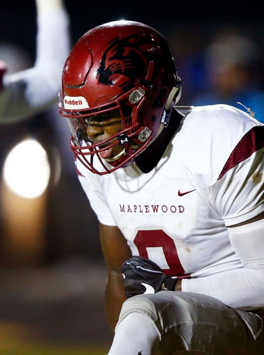 Maplewood's Makell Smith reacts after scoring a touchdown during their game against Nashville East Friday, Aug. 24, 2018, in Nashville, Tenn.