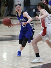 Montezuma's Elise Boulton, 21, drives past North Mahaska's