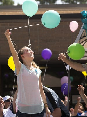 Brett Coomer, Houston Chronicle, via AP Cassidy Stay, the lone survivor of a family massacre in Texas, lets a balloon go during a community memorial Saturday in Spring, Texas. Cassidy was grazed in the head during Wednesday?s attack that killed her parents and four siblings. She played dead until the shooter left, then ? despite suffering a fractured skull ? managed to call 911. Cassidy Stay, the lone survivor of a family massacre in Texas, lets a balloon go during a community memorial at Lemm Elementary School on Saturday, July 12, 2014, in Spring, Texas. Cassidy was grazed in the head during Wednesday's attack that killed her parents and four siblings. She played dead until the shooter left, then despite suffering a fractured skull managed to call 911. (AP Photo/Houston Chronicle, Brett Coomer) MANDATORY CREDIT