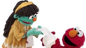 Meet Raya, left, who gets some toilet paper help from Sesame Street favorite, Elmo.