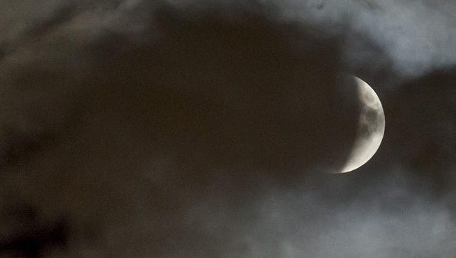 NOVI - SEPTEMBER 27: Clouds start to clear during a lunar eclipse Sunday, September 25, 2015 in metro Detroit. (Photo by Bryan Mitchell/Special to The Detroit News)
