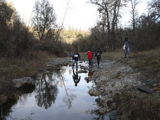 Kids go exploring through Whiskeytown National Recreation Area earlier this year.