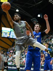 Colorado State Rams guard John Gillon (4) controls the ball away from Air Force Falcons center Zach Moer (41) in the first half at Moby Arena.