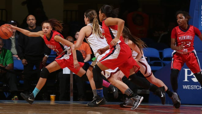 Albertus Magnus defeated Peekskill 56-49 during the Class A girls basketball final at the Westchester County Center in White Plains March 2, 2015.