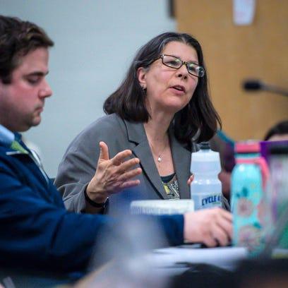 Liz Curry of the Burlington School Board speaks as