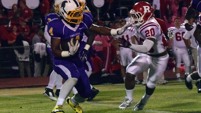 ASH's Kyle Smith (4, left) looks to get past Ruston's Devoseo Kinsey (20, right) Friday.