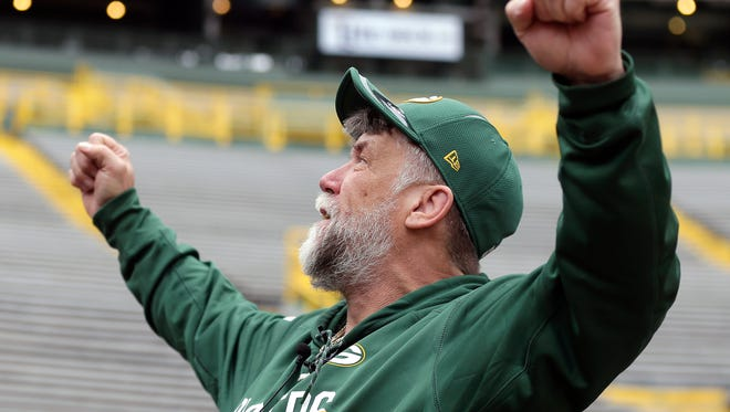 Dennis Schultze made a 50-day, 170-mile journey from Janesville to Lambeau Field by wheelchair to raise funds for charity. He completed the final stretch walking with a prosthetic leg on Saturday in Green Bay.
