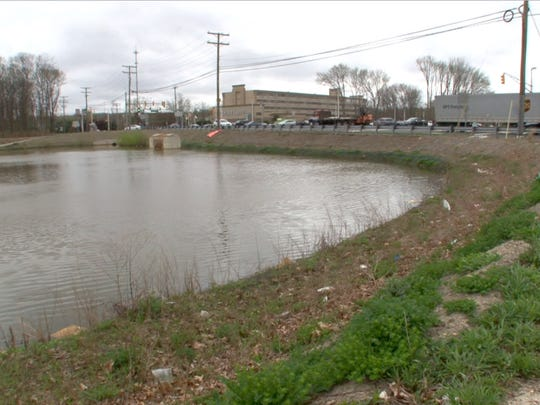 The retention basin at Hope Road and Route 36 where a husband and wife team of Jersey City police officers helped rescue an elderly woman whose car flew into water there on Easter Sunday.