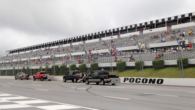 Jet dryers attempt to dry the track Sunday prior to the Pennsylvania 400 at Pocono Raceway.