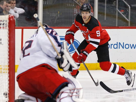 New Jersey Devils left wing Taylor Hall (9) scores a goal past Columbus Blue Jackets goaltender Sergei Bobrovsky (72) during the second period of an NHL hockey game Tuesday, Feb. 20, 2018, in Newark, N.J.