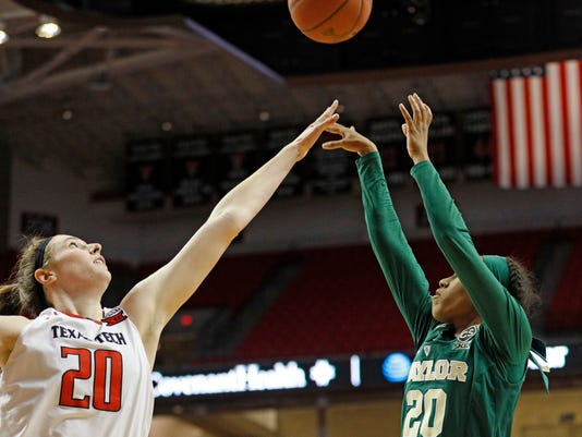 Baylor's Juicy Landrum (20) shoots the ball over Texas Tech's Brittany Brewer (20) during the second half of an NCAA college basketball game Saturday, Feb. 3, 2018, in Lubbock, Texas. (AP Photo/Brad Tollefson)