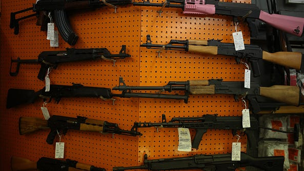 Civilian legal Kalashnikov variants are displayed for sale at a vendor's booth during the Fall 2015 Knob Creek Machine Gun Shoot in West Point, Kentucky, U.S., on Friday, Oct. 9, 2015. The Machine Gun Shoot is a three day bi-annual event that attracts gun dealers, collectors, and enthusiasts from all across America in what is considered one of the largest gun shows in the world dealing specifically with high-caliber weaponry.