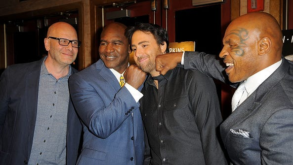 "From left: Lou Dibella, Evander Holyfield, Bert Marcus and Mike Tyson attend ""Champs"" New York Screening at Village East Cinema on March 12, 2015 in New York City."