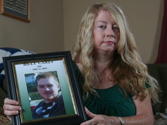 Helen Carey of Washington Township with a photo of her late son, Billy Carey, on August 22, 2016.