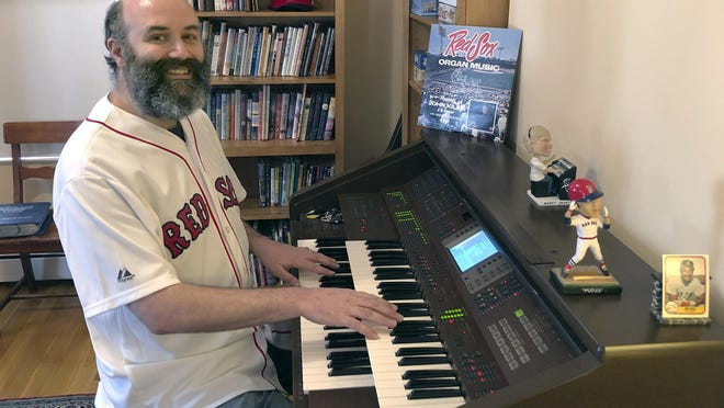 In this April 2020, photo provided by Josh Kantor, the Boston Red Sox organist plays the organ in his home in Cambridge, Mass. Each afternoon since what would have been opening day, Kantor has been live-streaming concerts of ballpark music and other fan requests from his home in an attempt to recreate the community feeling baseball fans might be missing while the sport is shut down during the coronavirus pandemic.
