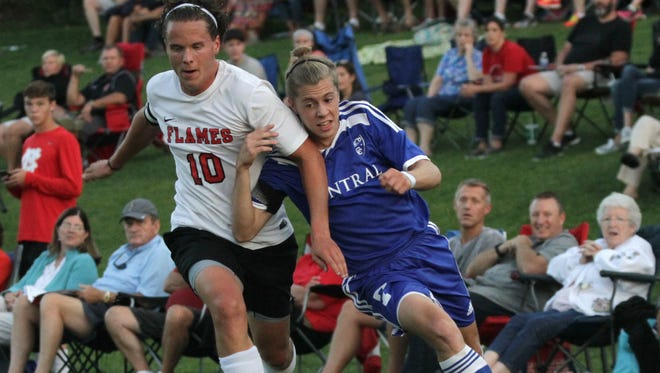 Mansfield Christian's Nick Mahek fends off Central Christian's Daniel Nussbaum during a match on Sept. 20 at Comstock Field.