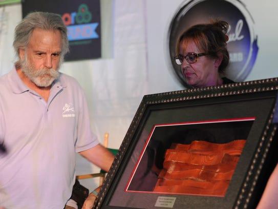 Bob Weir accepts the Les Paul Spirit Award at the Bonnaroo