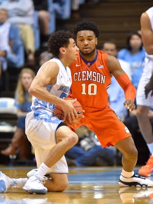 North Carolina Tar Heels guard Marcus Paige (5) looks to pass as Clemson Tigers guard Gabe DeVoe (10) defends in the first half at Dean E. Smith Center.