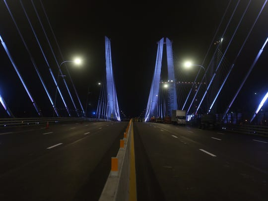 The Gov. Mario M. Cuomo Bridge is lit up Aug. 25, 2017, shortly before the Rockland County-bound span opens to traffic.