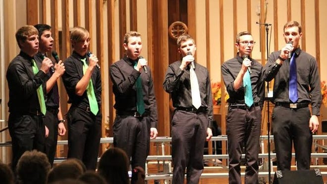 St. Mary's Springs Academy High School Music Department held their Fall Concert on Oct 19 at St. Mary's Church. Performing was the Vocal Jazz group, Jazz Band, and 50-member Concert Choir. Members of the boys choir perform a vocal arrangement.