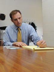 Chillicothe Mayor Luke Feeney takes notes as he talks