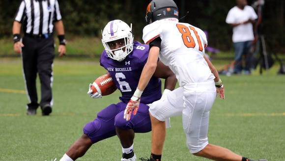 New Rochelle's Jared Baron is pressured by Mamaroneck's
