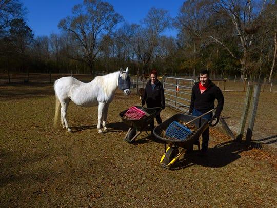 Volunteers Megan Crawford and Tyler Nimick help clean