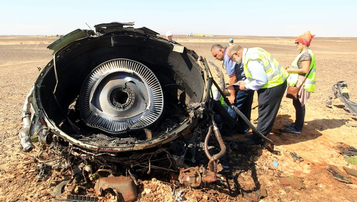 Egyptian investigators check debris from a crashed