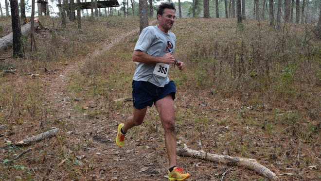 Daniel Ahrens competes in the half marathon run of the fourth annual Wild Azalea Trail Challenge held Saturday on the Wild Azalea Trail. The trail is 26 miles long and is the longest continuous trail in Louisiana. Runners and cyclists competed in various distances including a half marathon run; a 27-mile ultra run or bike; a 27-mile ultra duathlon and a 50-mile ultra run or bike.