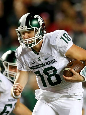 Michigan State QB Connor Cook carries the ball in the second quarter of the win over Rutgers Saturday.