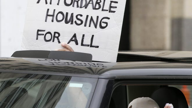 Advocates for low-wage workers demonstrated at City Hall in downtown Columbus on May 28, calling for more affordable housing and assistance for those facing eviction because of the coronavirus pandemic.
