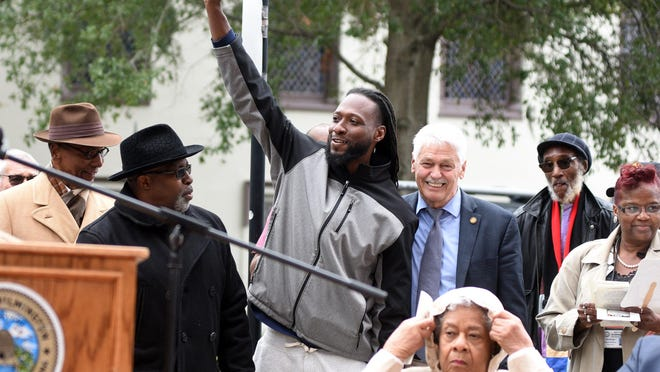 Wilmington Councilman Kevin Spears, pictured in the middle, is recognized during a dedication ceremony for a new North Carolina highway historical marker to the 1898 Wilmington Coup in 2019. He believes reparations in terms of investments in the Wilmington community are needed.