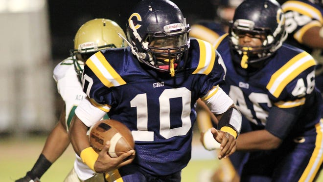 Leslie Westbrook, The Advertiser Carencro running back Tyriek Campbell (10) runs the ball against Acadiana in a high school football game Friday at Carencro High School. Carencro running back Tyriek Campbell (10) runs the ball against Acadiana in a high school football game Friday, October 31, 2014, at Carencro High School.