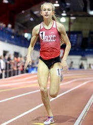 Katelyn Tuohy wins her heat of the mile during the