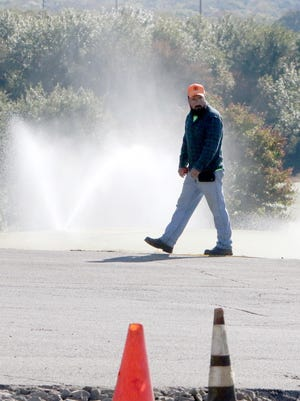 Elliott Godfrey with the Sebastian County Road Department checks the surface areas before repaving the parking lot and drive to the new Ben Geren Community Complex, 6100 Golf Course Loop, Monday, Oct. 5, in Ben Geren Regional Park. The former First Tee facility features clubhouse, course and range open to the public with PGA Professional Matt Brown on staff as well as the facility and course rentals for small and large golfing events.The complex also offers a junior golf academy and the game of Foot Golf.