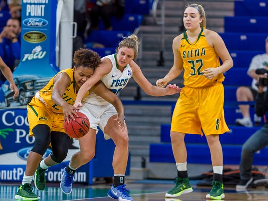 A lack of aggressive defense, like this from forward Haley Laughter in the home win against Siena on Dec. 9, was the main culprit in the Eagles' 82-73 loss at Illinois on Saturday.