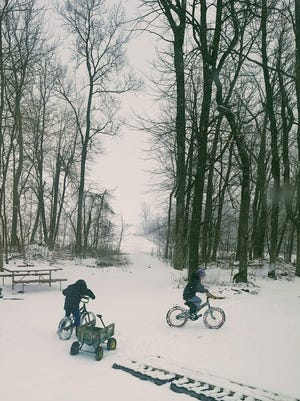 Spring can't come soon enough for farm kids Hank and Jack Tilderquist as they attempt to ride their bikes in the snow