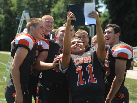 Lucas football players take a selfie