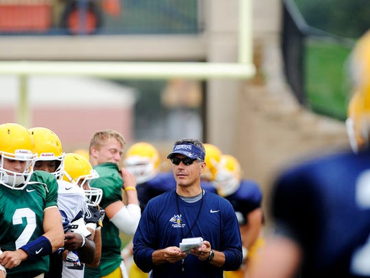 Augustana coach Jerry Olszewski, center, during a practice at Kirkeby-Over Stadium in Sioux Falls Wednesday, Aug. 21, 2013. (Joe Ahlquist / Argus Leader)