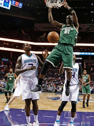 Tony Snell dunks over Charlotte's Marvin Williams on Tuesday.
