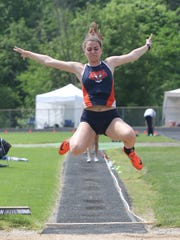 Galion's Marisa Gwinner competes in the long jump at the D-II regional meet at Lexington High School on Saturday.