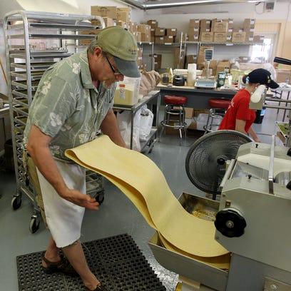 Jon Stadt, owner of Flour City Pasta, making lemon