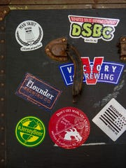 New Jersey brewery stickers on a bar at the 2nd Annual Boonton Main Street Rock & Brew Festival on June 2, 2018.