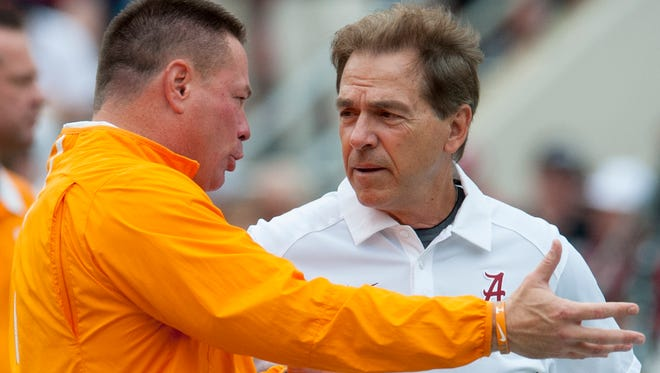 Tennessee head coach Butch Jones and Alabama head coach Nick Saban talk before their game at Bryant-Denny Stadium in Tuscaloosa, Ala. on Saturday October 24, 2015.
